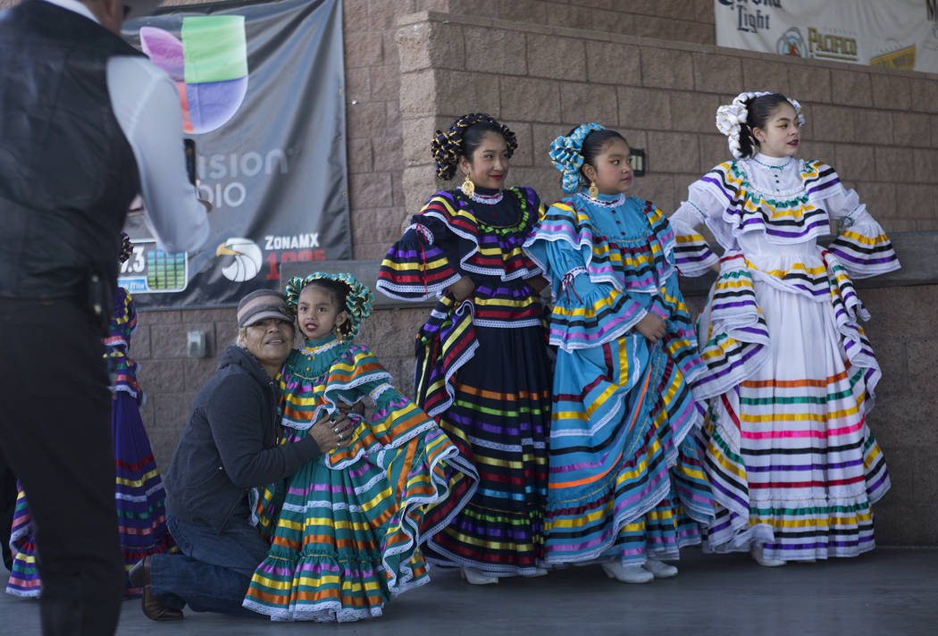 Grupo Folkorico Libertad de las Vegas watches as other members of their group performs at Broadacres Marketplace in North Las Vegas, Sunday, Dec. 2, 2018. Rachel Aston Las Vegas Review-Journal @ro ...