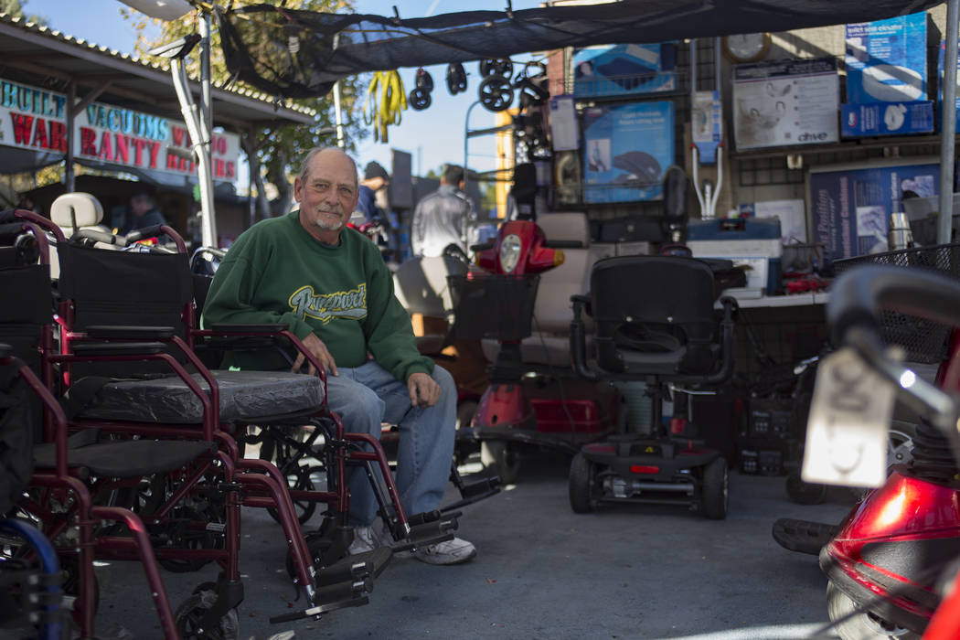 Brad Stedding sits at his booth Mobility Aids at Broadacres Marketplace in North Las Vegas, Sunday, Dec. 2, 2018. Known affectionately as the Wheelchair Man, Stedding has been selling wheelchairs ...
