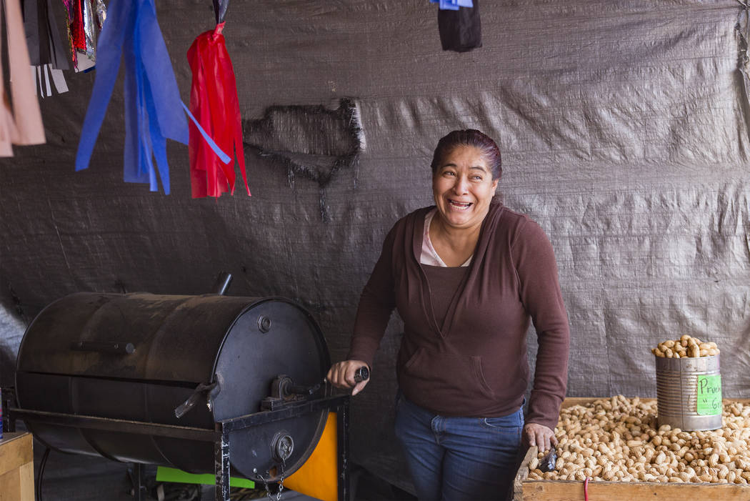 Bella Martinez roasts peanuts at the Botana Puebla booth at Broadacres Marketplace in North Las Vegas, Saturday, Dec. 1, 2018. The booth sells traditional Mexican snacks, candy, and piatas homemad ...