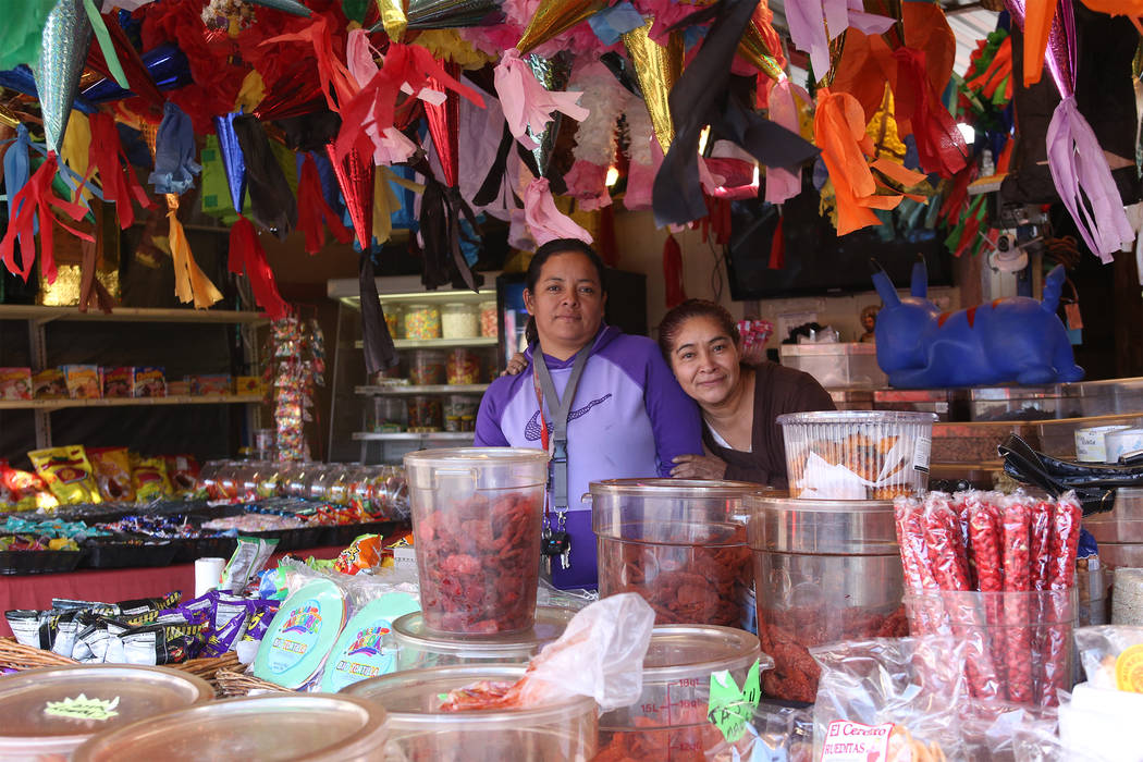 Mireya Lopez, left, stands with her employee Bella Martinez at the Botana Puebla booth at Broadacres Marketplace in North Las Vegas, Saturday, Dec. 1, 2018. The booth sells traditional Mexican sna ...