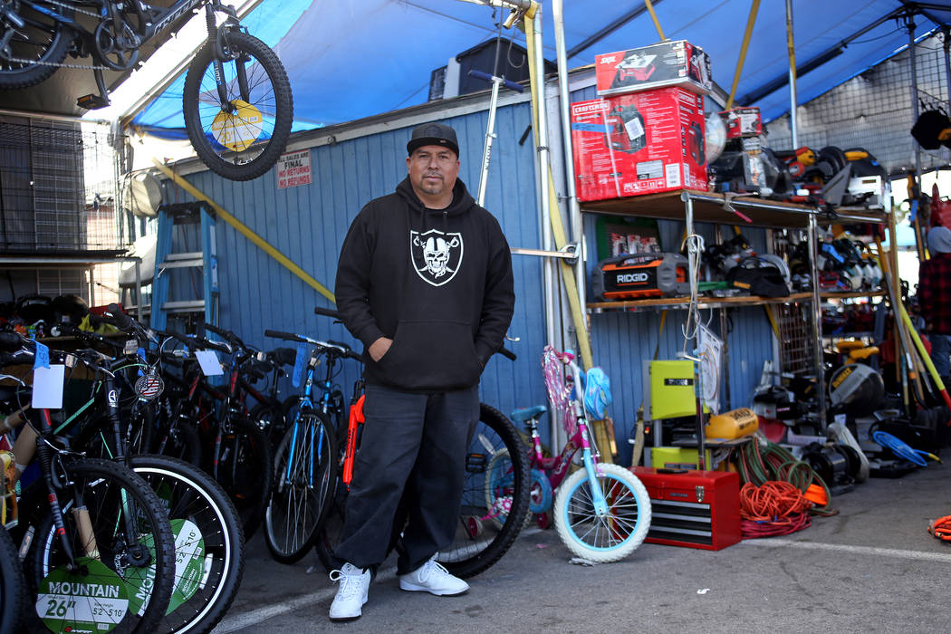 Francisco stands outside his Villas Tools booth at Broadacres Marketplace in North Las Vegas, Saturday, Dec. 1, 2018. Francisco has been selling bikes, tools, lawn mowers and other machinery for e ...