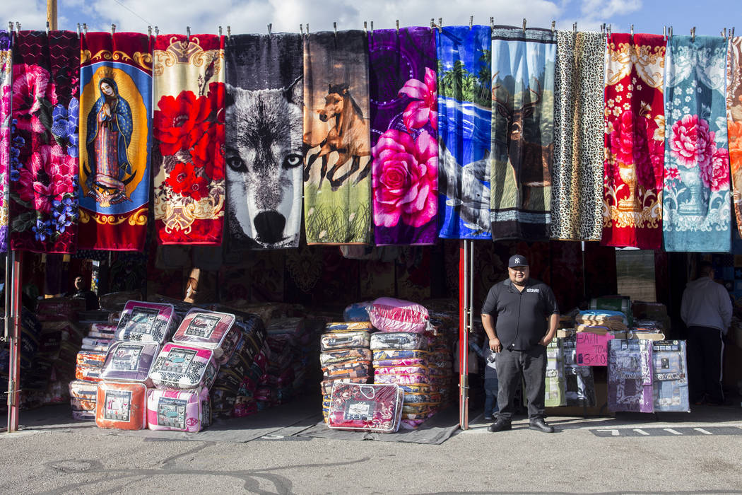 Luis Gonzales stands outside Gonzales Blankets & Rugs at Broadacres Marketplace in North Las Vegas, Saturday, Dec. 1, 2018. Gonzales is the son of the owner and a main player now in the family ...