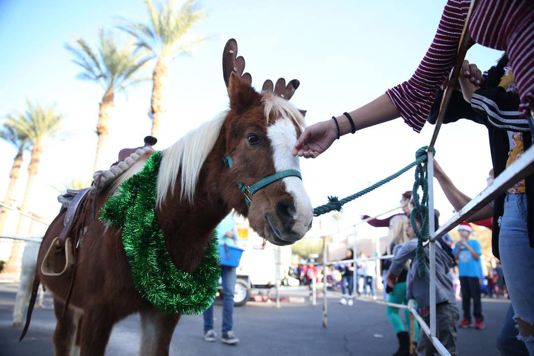 People pet a pony during the annual WinterFest event at the Henderson Events Plaza in Henderson, Saturday, Dec. 8, 2018. Erik Verduzco Las Vegas Review-Journal @Erik_Verduzco
