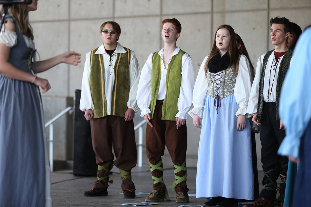 Green Valley's Madrigal singers from left Spencer Lewis, 18, Brendan Stephens, 15, Kayleigh Fick, 15, and Tristan Frayer, 16, perform during the annual WinterFest event at the Henderson Events Pla ...