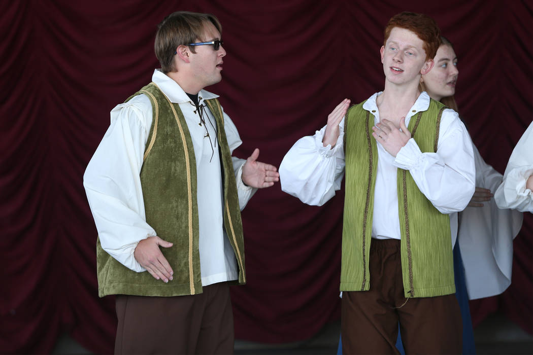 Green Valley's Madrigal singers Spencer Lewis, 18, left, and Brendan Stephens, 15, perform during the annual WinterFest event at the Henderson Events Plaza in Henderson, Saturday, Dec. 8, 2018. Er ...
