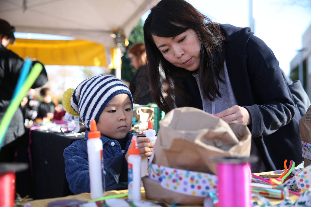 Chie Shoji, right, with her son Kento, 4, make a hat during the annual WinterFest event at the Henderson Events Plaza in Henderson, Saturday, Dec. 8, 2018. Erik Verduzco Las Vegas Review-Journal @ ...