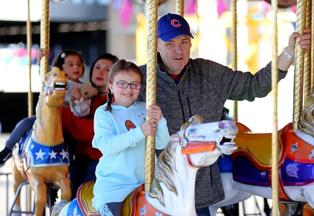 Matt Feltz and his daughter Kaylin, 7, of Henderson, attend the annual WinterFest event at the Henderson Events Plaza in Henderson, Saturday, Dec. 8, 2018. Erik Verduzco Las Vegas Review-Journal @ ...
