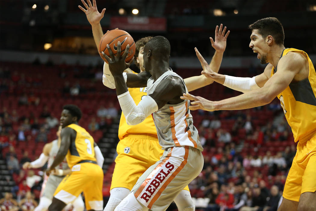 UNLV Rebels forward Mbacke Diong (34) is pressure by Valparaiso Crusaders guard Ryan Fazekas (35) and center Jaume Sorolla (14) during the second half of the basketball game at the Thomas & Mack C ...