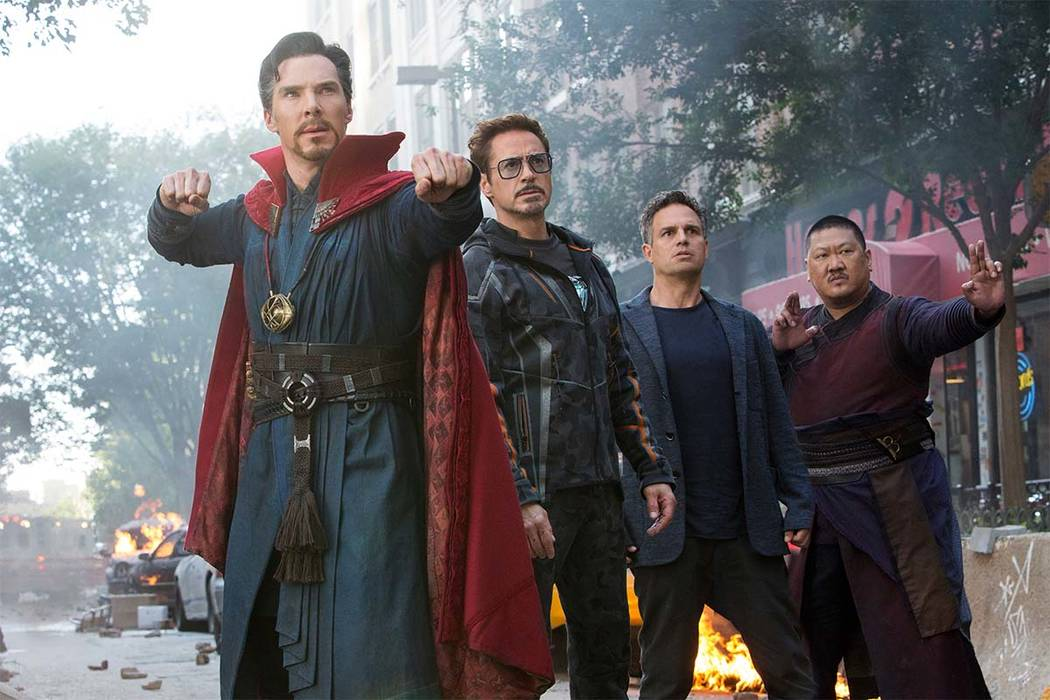 """This image released by Marvel Studios shows, from left, Benedict Cumberbatch, Robert Downey Jr., Mark Ruffalo and Benedict Wong in a scene from """"Avengers: Infinity War."""" (Marvel Studios ..."""