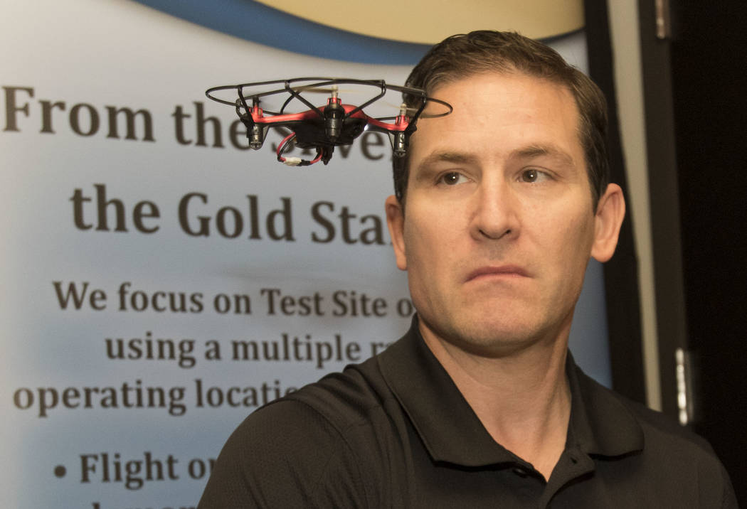 Dr. Chris Walach, director of operations of unmanned aviation for Nevada Institute for Autonomous Systems, flies a small drone during a flight demonstration at his office in Las Vegas on Wednesday ...