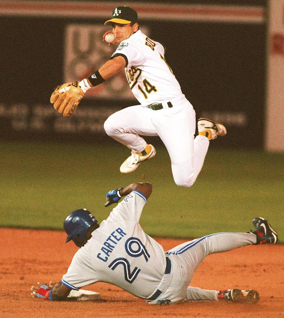 Toronto's Joe Carter breaks up a double play chance for Oakland A's shortstop Mike Bordick during the first inning of their game at Cashman Field in Las Vegas on April 3, 1996. (Review-Journal File)