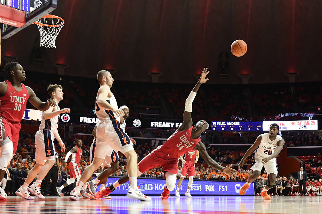 CHAMPAIGN, IL - DECEMBER 08: Cheikh Mbacke Diong (SEN)(34) forward University of Nevada Las Vegas (UNLV) Runnin Rebels goes to the floor for a rebound against the University of Illinois Fighting I ...