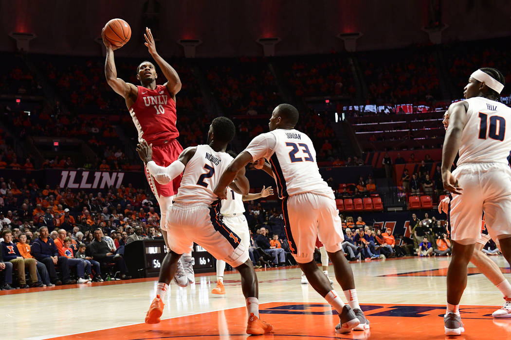 CHAMPAIGN, IL - DECEMBER 08: Shakur Juiston (10) forward University of Nevada Las Vegas (UNLV) Runnin Rebels jumps for two points over Kipper Nichols (2) forward and Aaron Jordan (23) guard Univer ...
