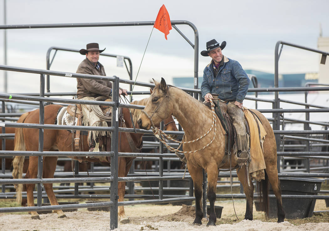 Clint Potts, right, from Sand Springs, Mont., and Chris Dutton, from Grass Range, Mont., exercise saddle horses on Tuesday, Dec. 4, 2018, at the UNLV Intramural Field, in Las Vegas. Benjamin Hager ...