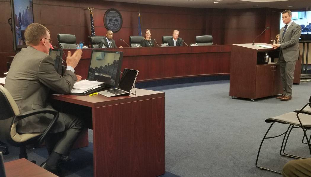 Karl Bennison, chief of the state Gaming Control Board's Enforcement Division, left, answers questions from Control Board members Terry Johnson, chairwoman Becky Harris and Shawn Reid, and Scott N ...