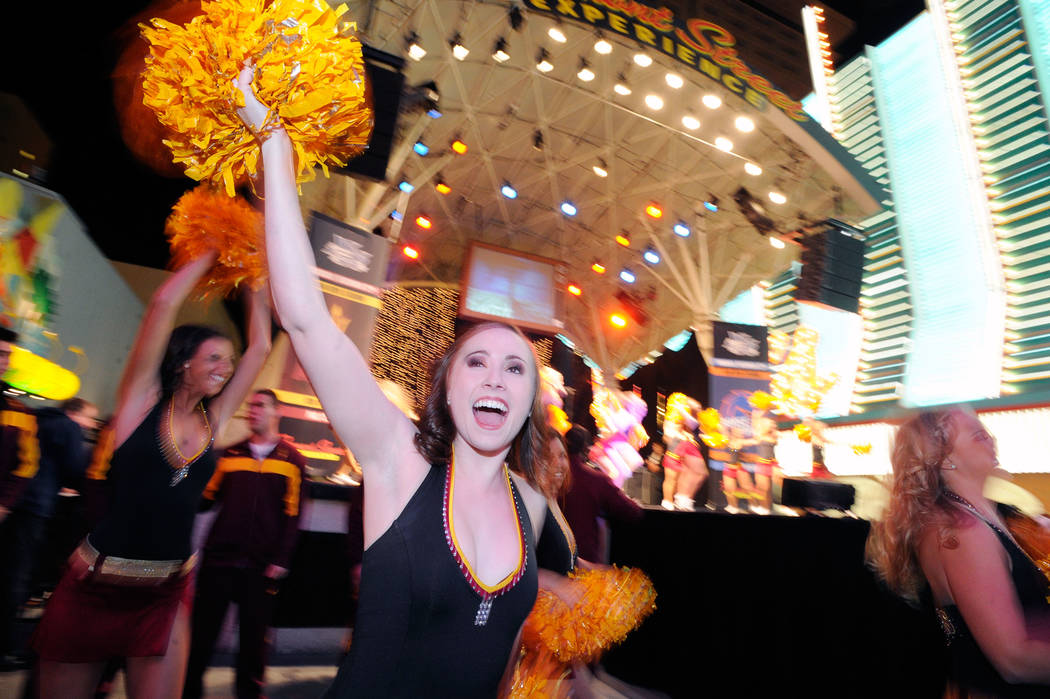 Arizona State University cheerleader Mary Haddock cheers on her school's team during a pep rally for 20th annual Maaco Bowl Las Vegas at the Fremont Street Experience on Wednesday, Dec. 21, 2011 b ...
