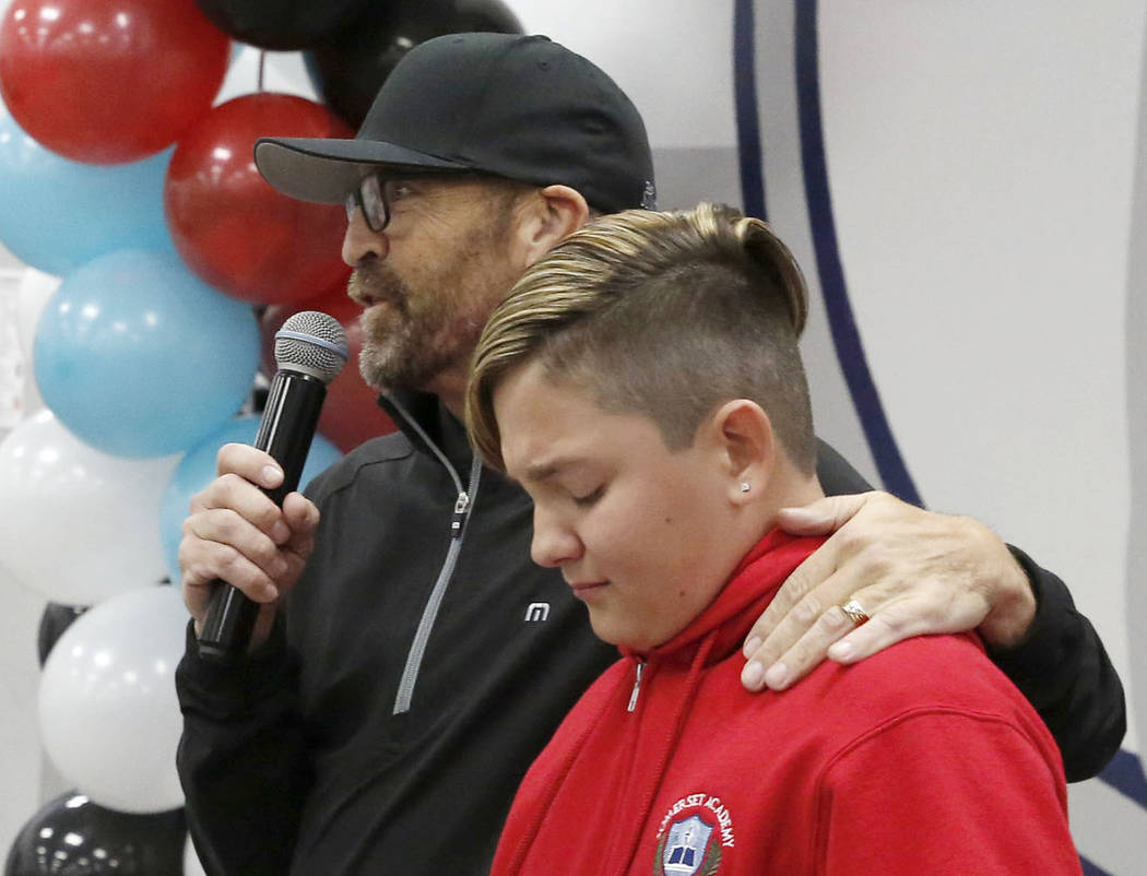 Osker Gamboa, right, who received a heart transplant on April 30, 2017, gets emotional as he was honored by one of the longest living organ transplant recipient, Simon Keith, founder of the Simon ...
