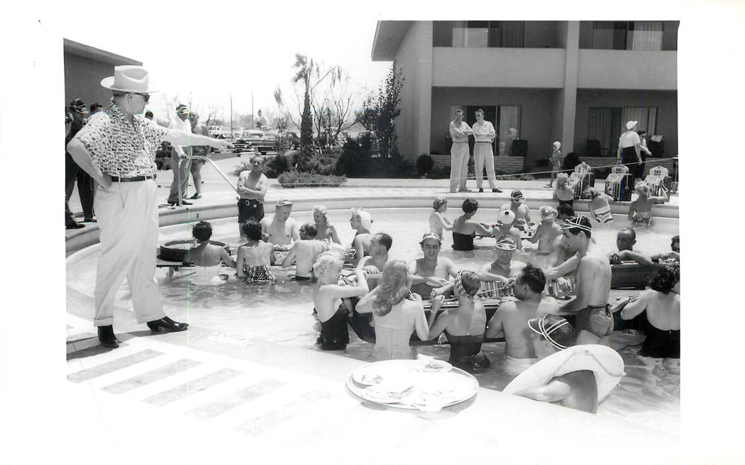 The Sands floating crap game, roulette, and blackjack for summer fun. Freidman, owner of the Sands is standing out of the pool pointing, July, 1953. (File Photo/Las Vegas News Bureau)