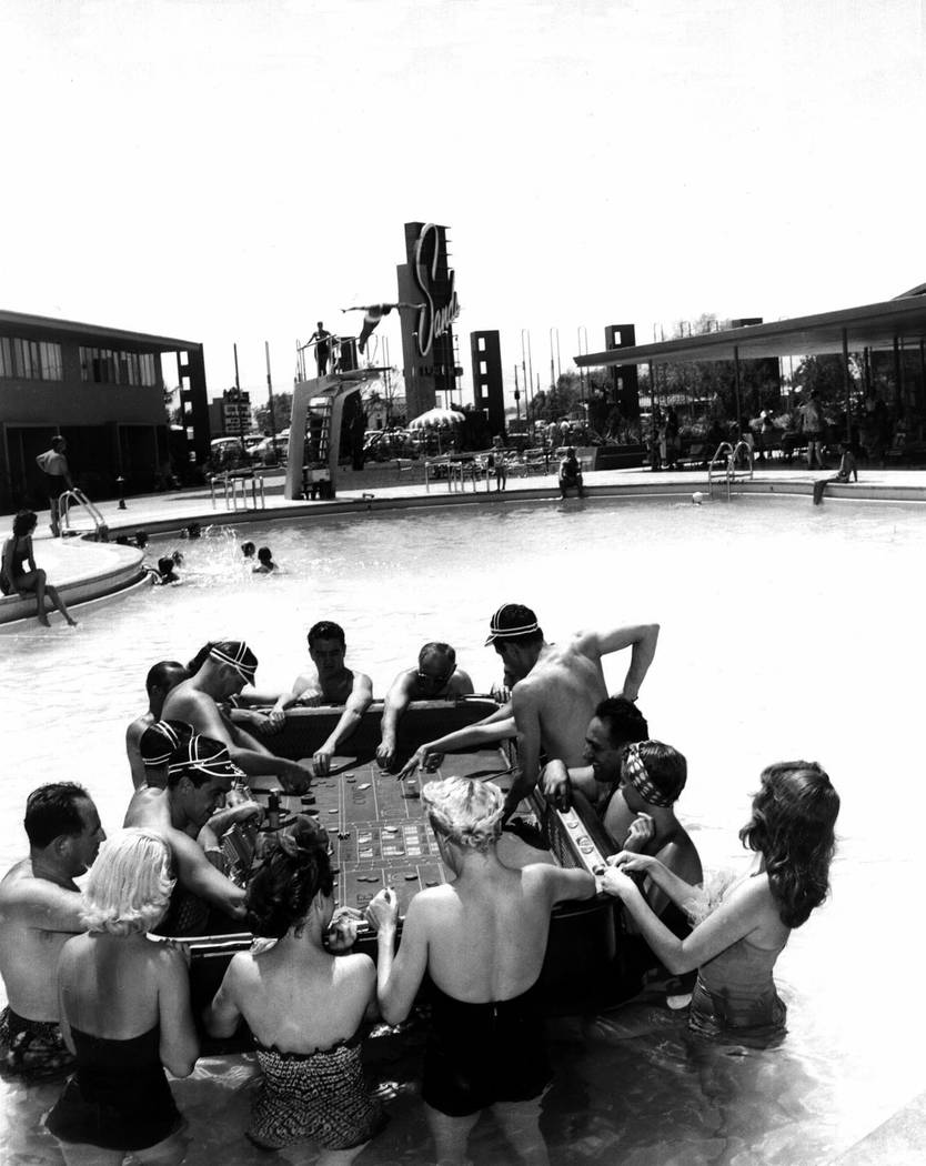 Gamblers play craps in the pool at the Sands in Las Vegas in this 1953 Don English photograph. Seldom can a Las Vegas fun seekers tan and cool off all at the same time. Thanks to innovative public ...