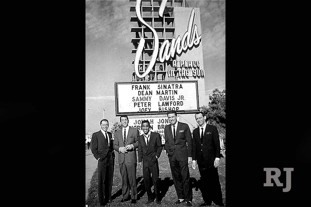 """Members of the legendary """"Rat Pack,"""" from left, Frank Sinatra, Dean Martin, Sammy Davis Jr., Peter Lawford and Joey Bishop pose in front of the marquee for the Sands hotel-casino in Las Vegas in t ..."""