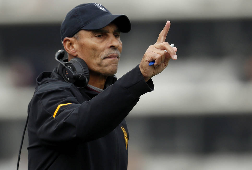 In this Saturday, Oct. 6, 2018, file photo, Arizona State head coach Herm Edwards gestures during the first half of an NCAA college football game in Boulder, Colo. (AP Photo/David Zalubowski, File)