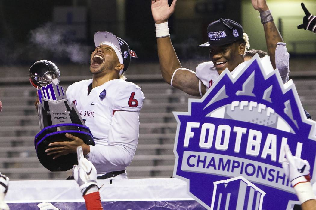 Fresno State quarterback Marcus McMaryion (6) celebrates with the Mountain West Conference Championship trophy after the team's 19-16 win over Boise State during an NCAA college football game for ...