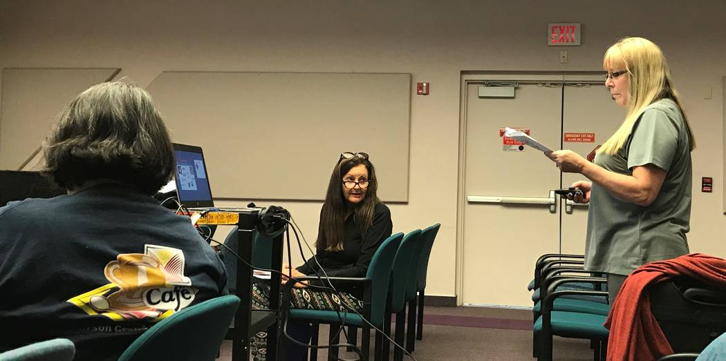 Jet Spore, a volunteer with the AARP office of Las Vegas, gives a presentation on how to avoid romance-related online scams at the Enterprise Library. Rachel Spacek Las Vegas Review-Journal