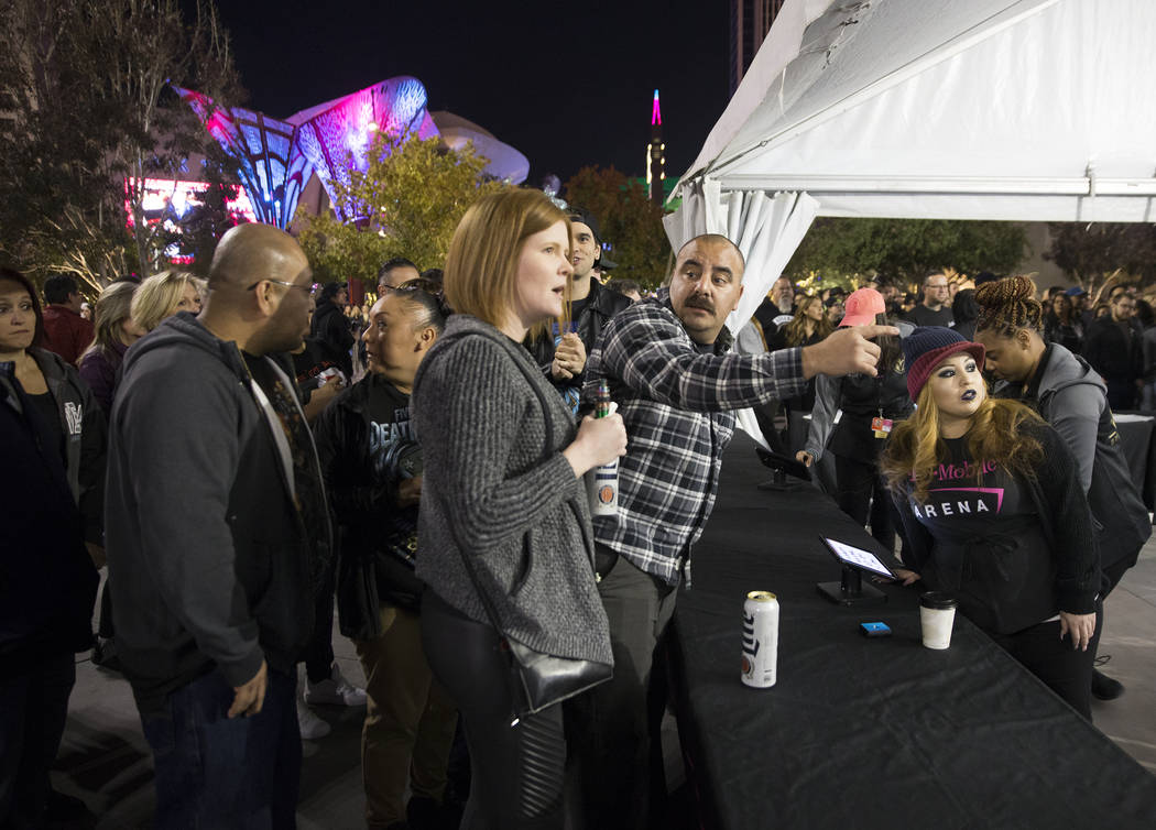 Concert goers buy merchandise before the start of the Metallica show outside T-Mobile Arena on Monday, Nov. 26, 2018, in Las Vegas. Benjamin Hager Las Vegas Review-Journal