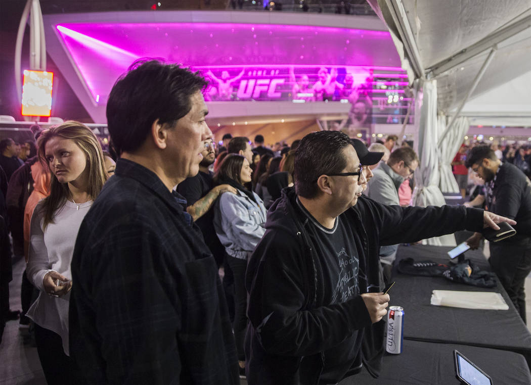 Reuben Parras, right, points out a shirt he wants to try on before the start of the Metallica show outside T-Mobile Arena on Monday, Nov. 26, 2018, in Las Vegas. Benjamin Hager Las Vegas Review-Jo ...