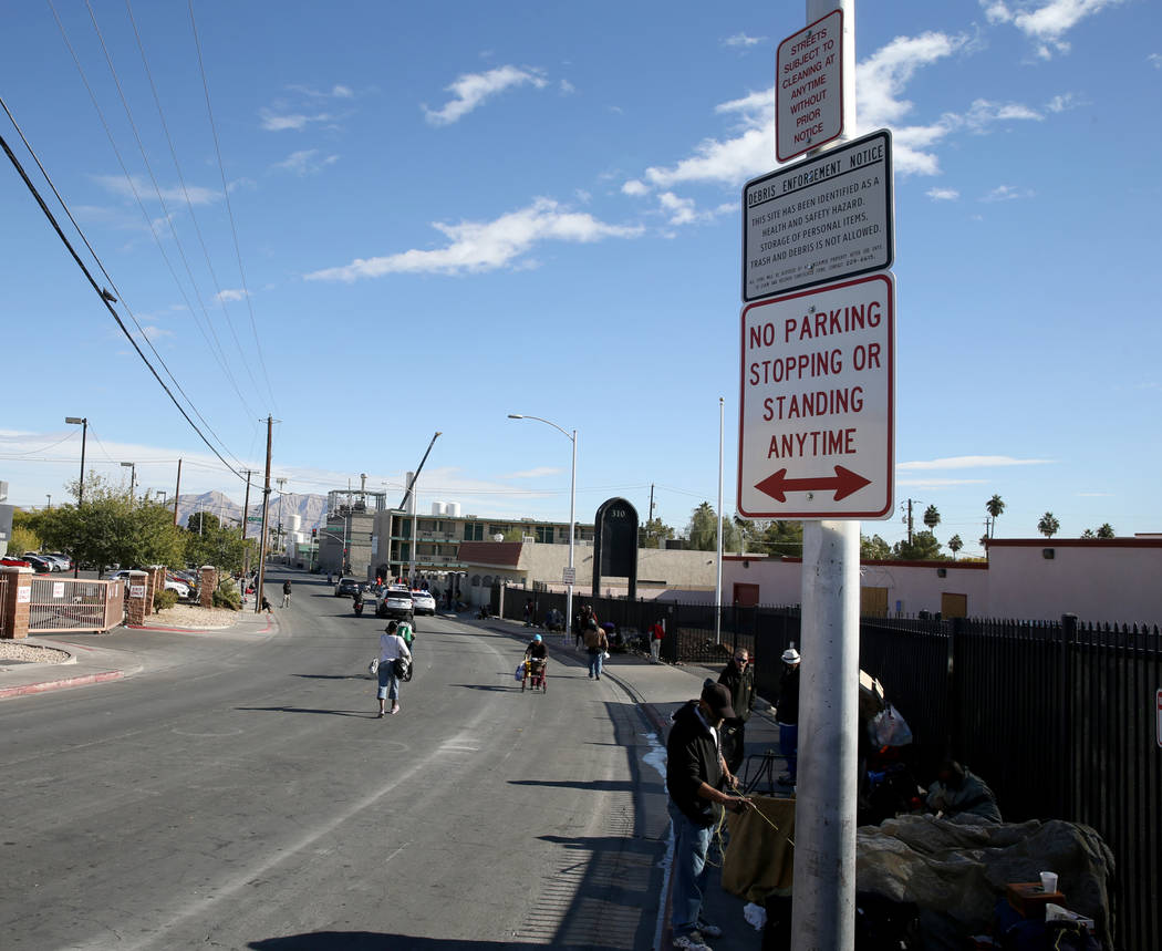 """People congregate under """"No Parking"""" signs on Foremaster Lane between Main Street and Las Vegas Boulevard Wednesday, Nov. 28, 2018. K.M. Cannon Las Vegas Review-Journal @KMCannonPhoto"""