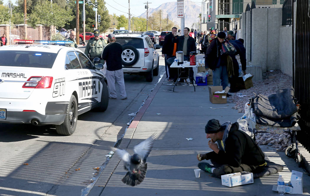 Las Vegas police and marshals cite a person for parking in a red zone on Foremaster Lane near Las Vegas Boulevard Wednesday, Nov. 28, 2018. The person had stopped to give out food. K.M. Cannon Las ...
