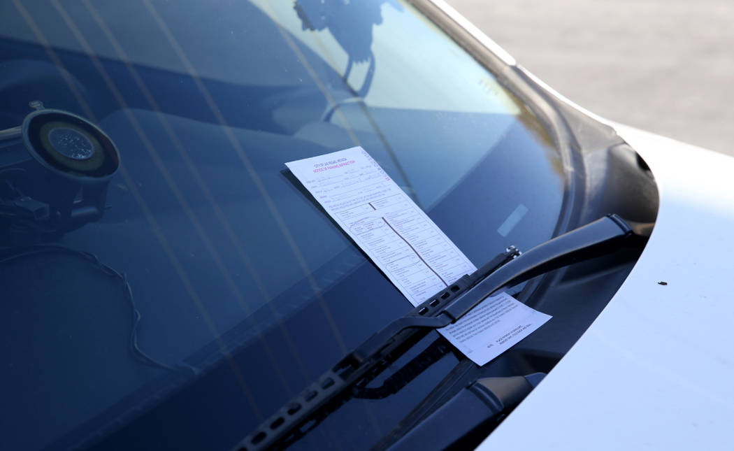 A citation on Joey Lankowski's car where he was distributing food on Foremaster Lane near Las Vegas Boulevard Wednesday, Nov. 28, 2018. Lankowski was cited for parking in a red zone. K.M. Cannon L ...