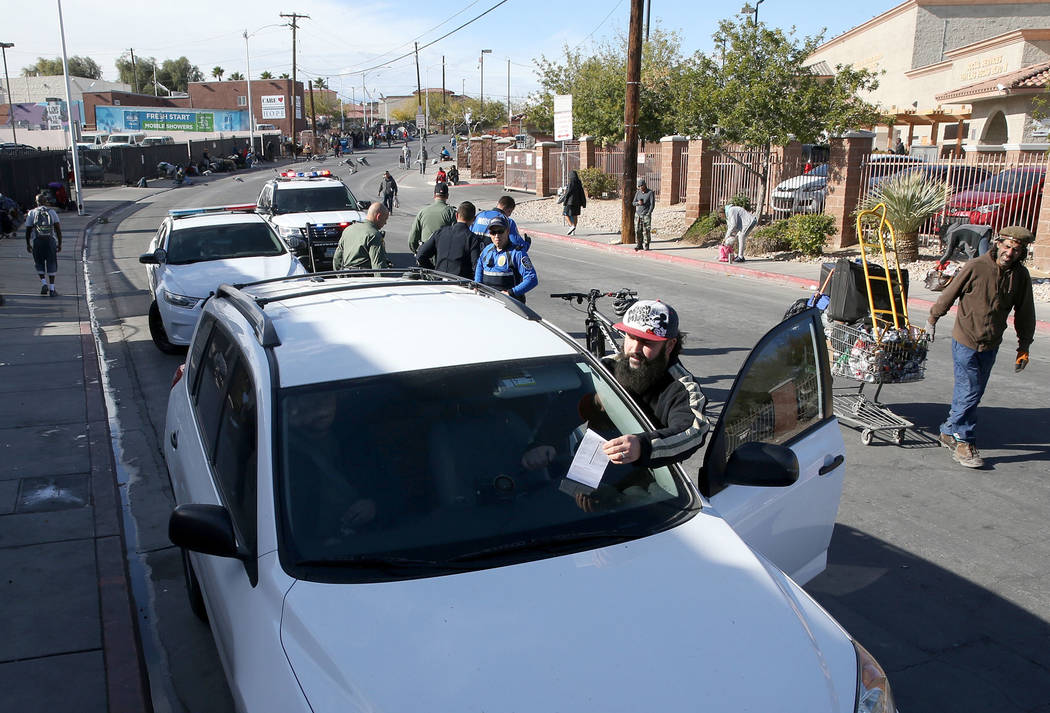 Joey Lankowski grabs a citation off his windshield where he was distributing food on Foremaster Lane near Las Vegas Boulevard Wednesday, Nov. 28, 2018. Lankowski was cited for parking in a red zon ...