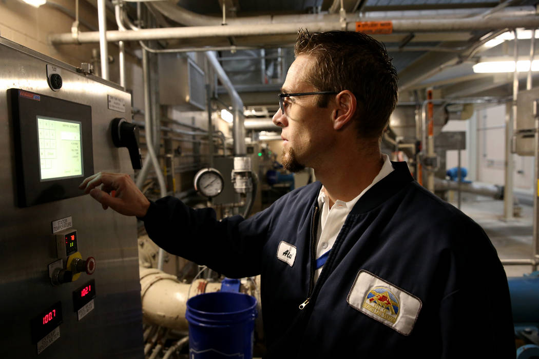 Alan Wolfley, a Grade 3 operator adjusts a centrifuge in the solids facility at the City of North Las Vegas Water Reclamation Facility, checks a system Friday, Nov. 30, 2018. K.M. Cannon Las Vegas ...