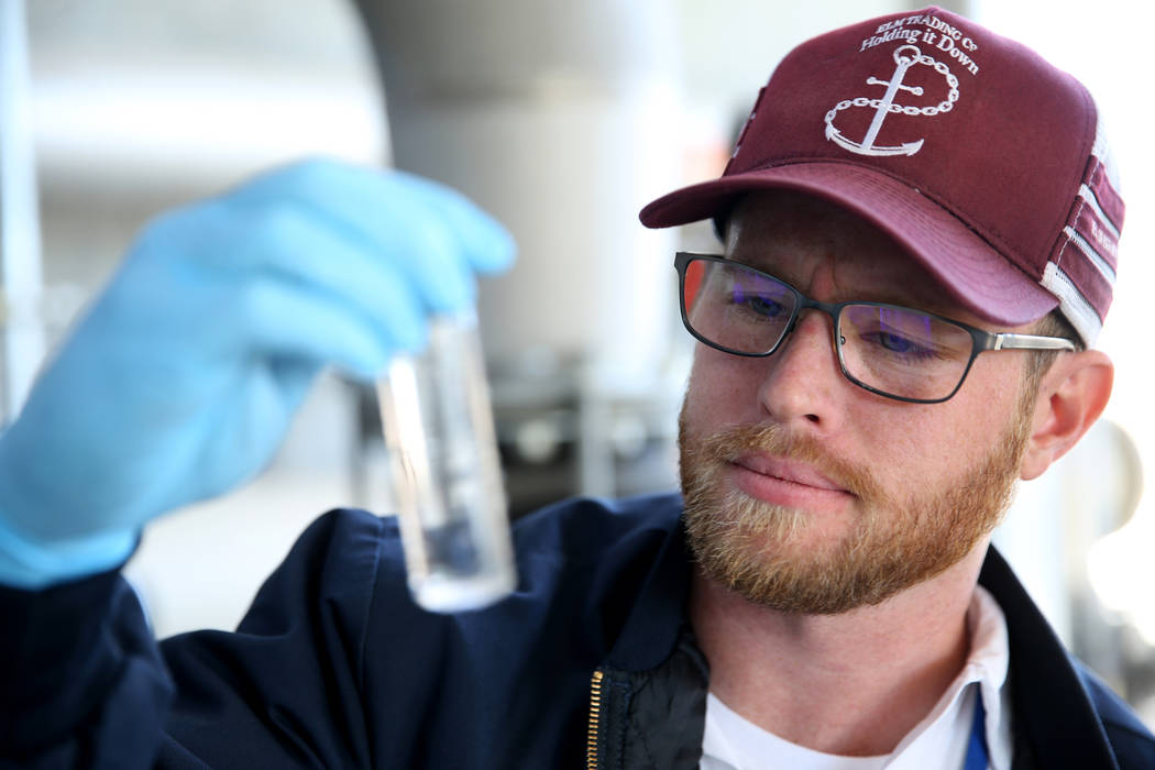 Matthew Anderson, a senior quality analyst at the City of North Las Vegas Water Reclamation Facility, checks a combined permeate grab Monday, Dec. 3, 2018. K.M. Cannon Las Vegas Review-Journal @KM ...