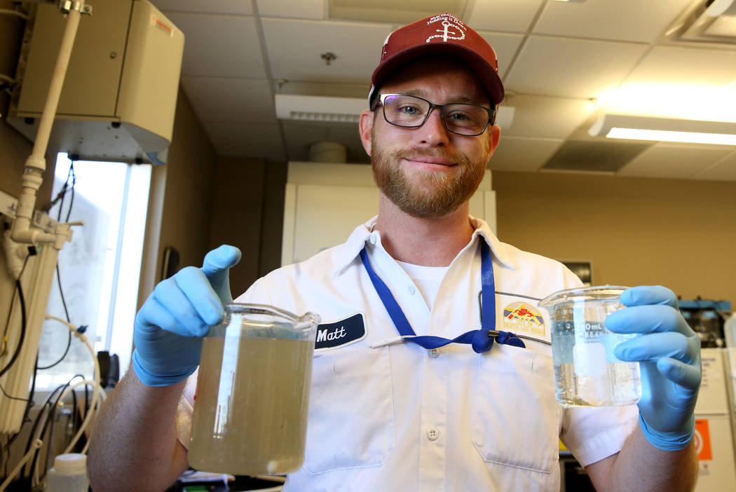 Matthew Anderson, a senior quality analyst at the City of North Las Vegas Water Reclamation Facility, shows water that comes into the facility left, and water that goes out of the facility Monday, ...