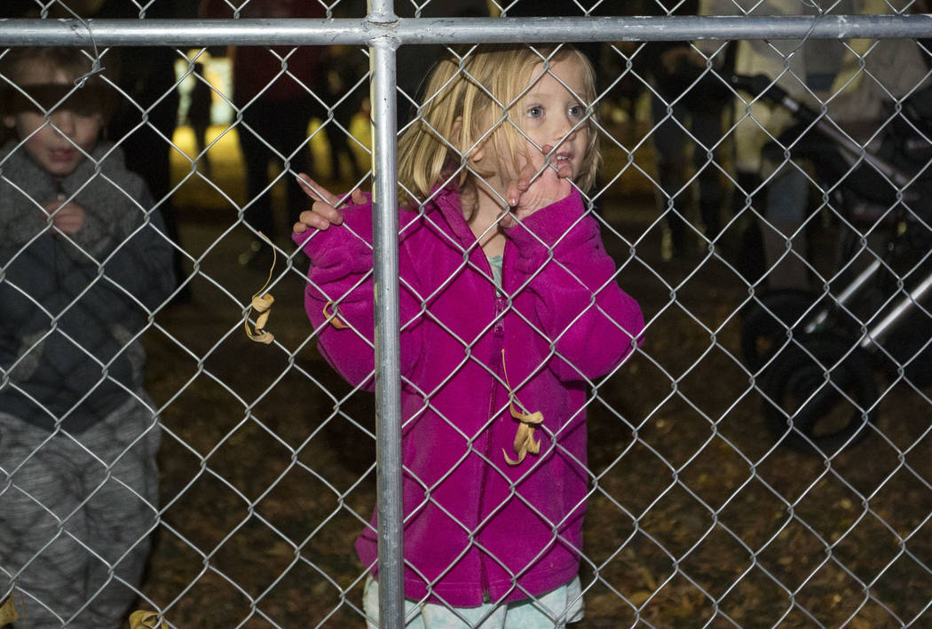 North Las Vegas resident Eloise Pepka, 3, tries to gets a glimpse of Santa Claus during a tree lighting ceremony at Cowboy Christmas at Floyd Lamb Park at Tule Springs in Las Vegas on Saturday, De ...