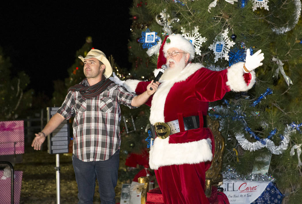 Emcee Walt Turner and Santa Claus prepare to light the Christmas tree during Cowboy Christmas at Floyd Lamb Park at Tule Springs in Las Vegas on Saturday, Dec. 1, 2018. Richard Brian Las Vegas Rev ...