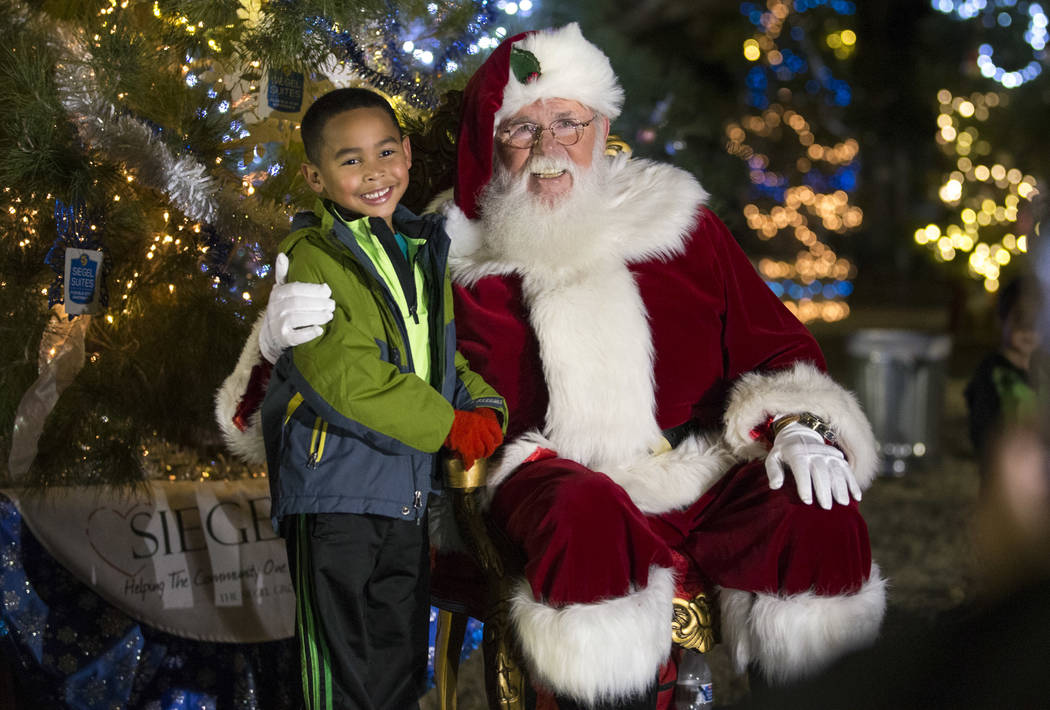 North Las Vegas resident Jaiden Brown, 5, poses with Santa Claus during Cowboy Christmas at Floyd Lamb Park at Tule Springs in Las Vegas on Saturday, Dec. 1, 2018. Richard Brian Las Vegas Review-J ...