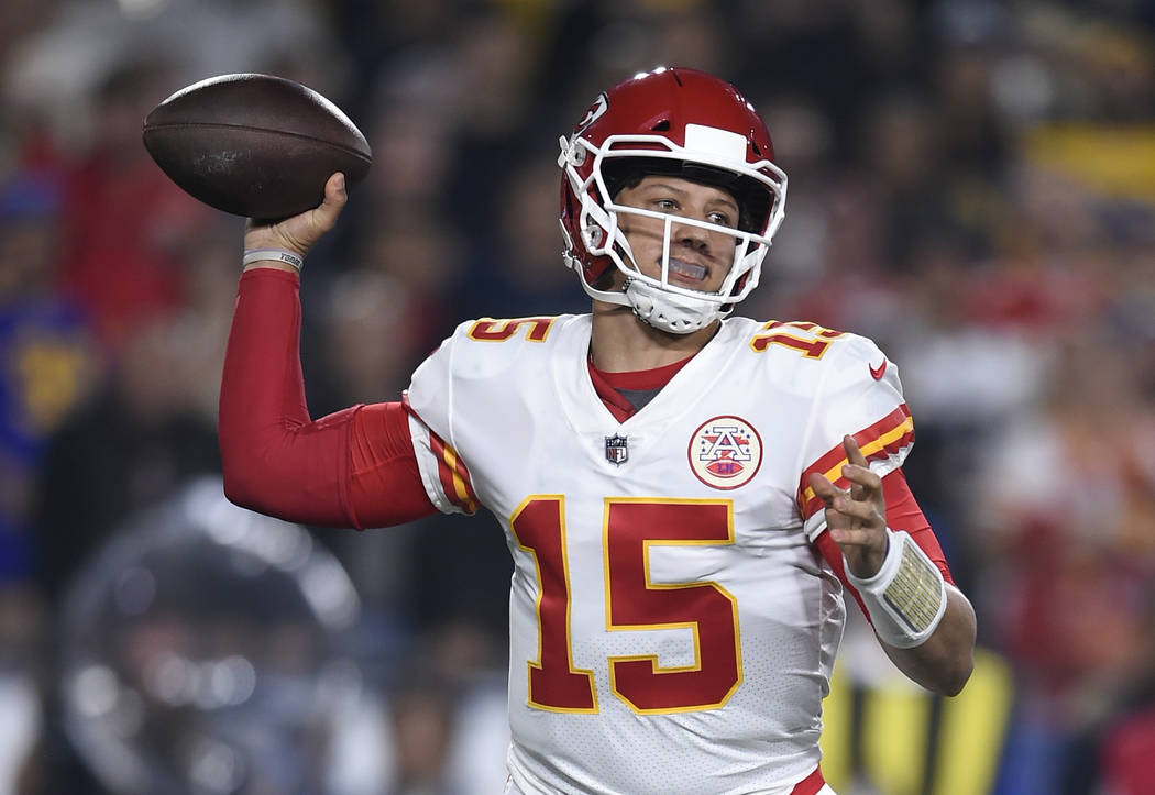 Kansas City Chiefs quarterback Patrick Mahomes passes against the Los Angeles Rams during the first half of an NFL football game, Monday, Nov. 19, 2018, in Los Angeles. (AP Photo/Kelvin Kuo)