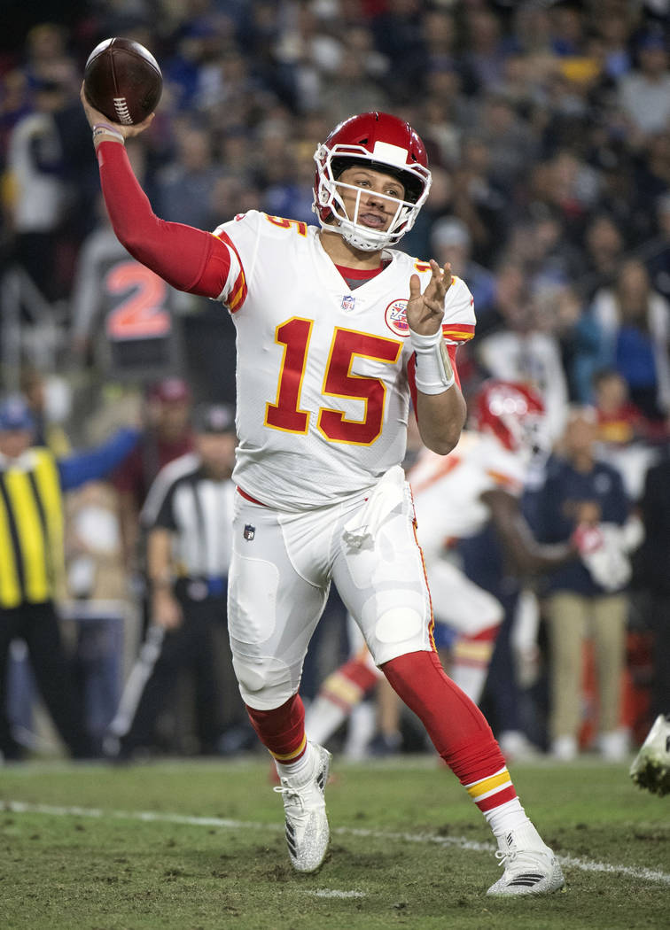 FILE - In this Nov. 19, 2018, file photo, Kansas City Chiefs quarterback Patrick Mahomes throws a pass during an NFL football game against the Los Angeles Rams, in Los Angeles. The Oakland Raiders ...