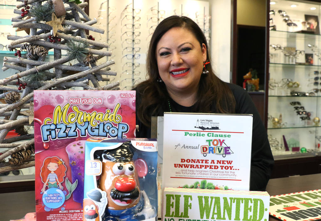 Perla Gumm, office manager at Optic Gallery, poses for a photo at her store on Wednesday, Nov. 28, 2019, in Las Vegas. Gumm has spent the past few years collecting toys for kids for the Las Vegas ...