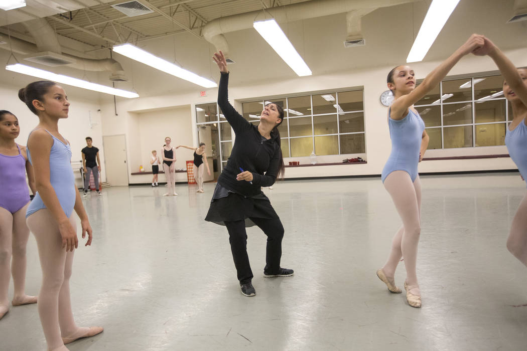 "Camilla, left, waits for direction from Repertoire Tara Foy, center, during a rehearsal for the ""Nutcracker"" at the Nevada Ballet Theatre in Las Vegas on Friday. Richard Brian Las Vegas Review-Jo ..."