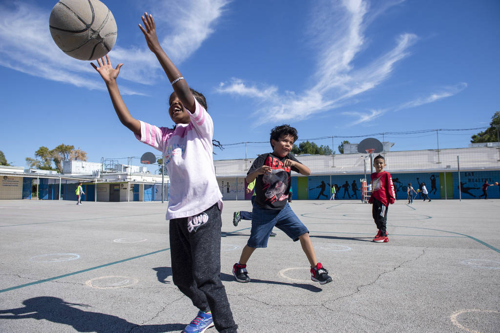 "Kids play basketball during recess at Walter Bracken Elementary School in Las Vegas, Wednesday, Oct. 17, 2018. Nevada Medical Center, in partnership with nonprofit Playworks, launches its ""Recess ..."