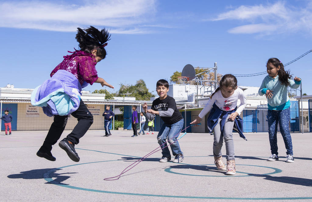 Children play with a jumprope during recess at Walter Bracken Elementary School in Las Vegas, Wednesday, Oct. 17, 2018. Nevada Medical Center, in partnership with nonprofit Playworks, launches its ...