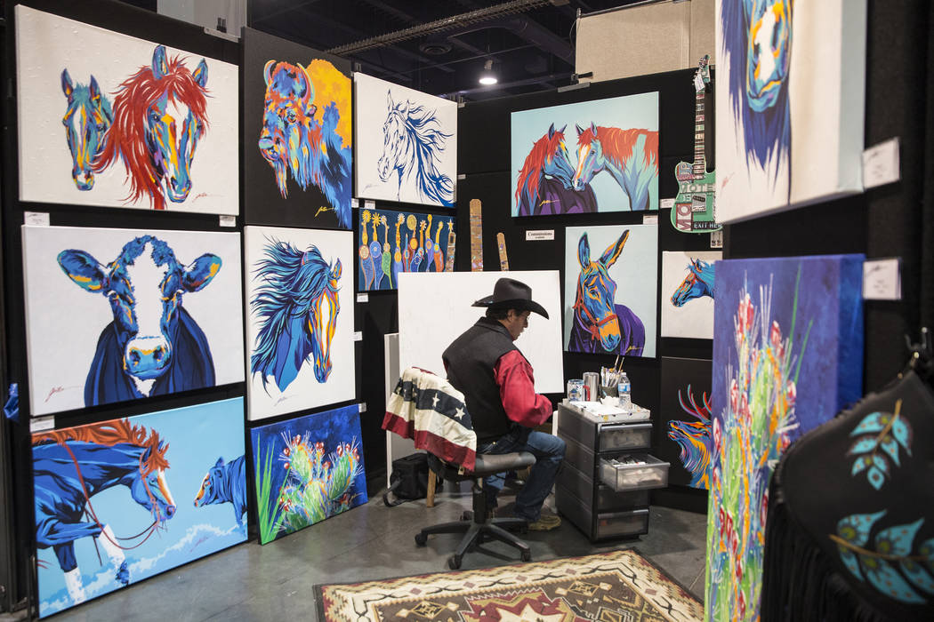 Artist Lyndon Gaither, from Dallas, Texas, prepares to paint at Contemporary Western Art at Cowboy Christmas at the Las Vegas Convention Center on Thursday, Dec. 6, 2018, in Las Vegas. Benjamin Ha ...