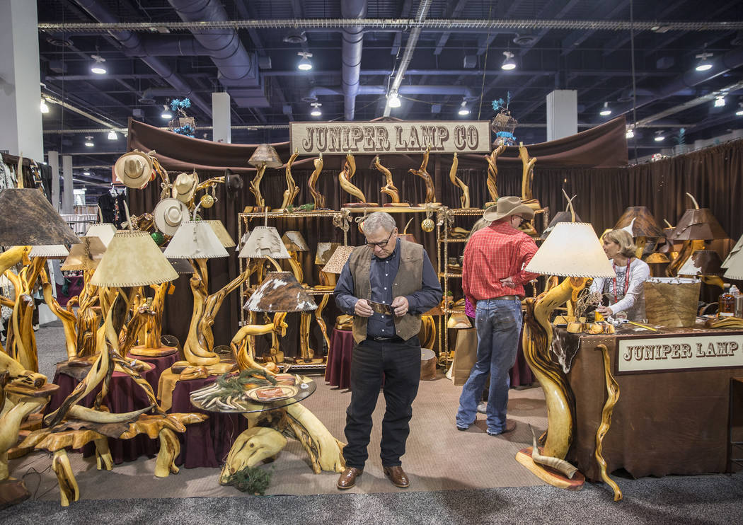 Shoppers explore Juniper Lamp Co. at Cowboy Christmas at the Las Vegas Convention Center on Thursday, Dec. 6, 2018, in Las Vegas. Benjamin Hager Las Vegas Review-Journal