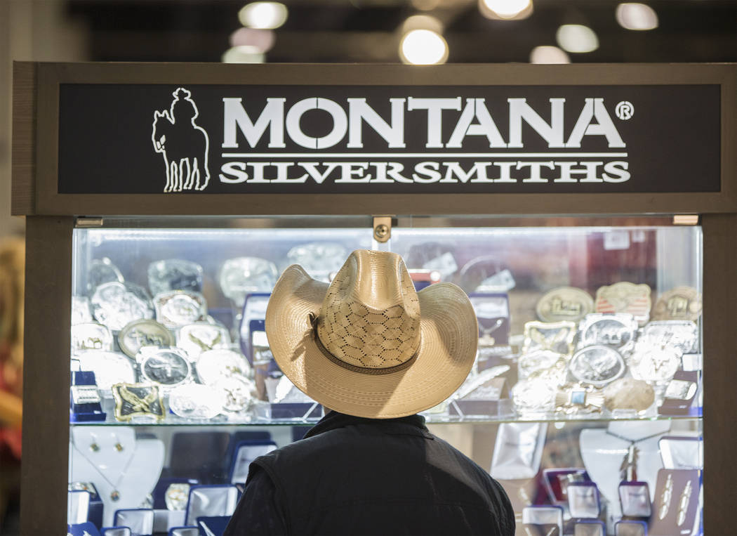 A shopper looks at watches from Montana Silversmiths in the South Halls during Cowboy Christmas at the Las Vegas Convention Center on Thursday, Dec. 6, 2018, in Las Vegas. Benjamin Hager Las Vegas ...