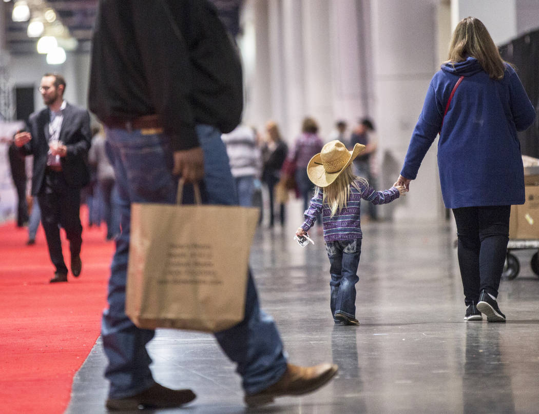 Shoppers walk the South Halls during Cowboy Christmas at the Las Vegas Convention Center on Thursday, Dec. 6, 2018, in Las Vegas. Benjamin Hager Las Vegas Review-Journal
