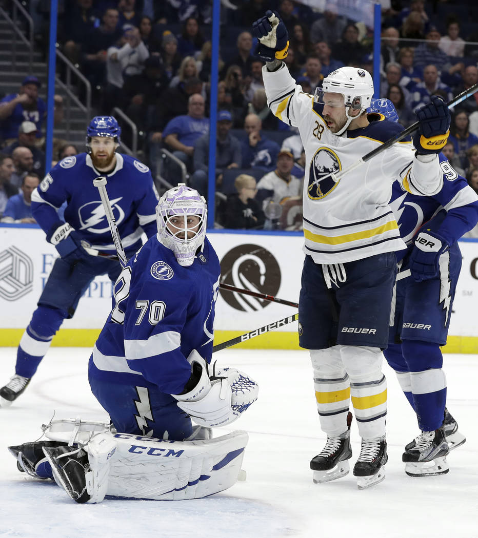 Buffalo Sabres center Zemgus Girgensons (28) celebrates his goal past Tampa Bay Lightning goaltender Louis Domingue (70) during the first period of an NHL hockey game Thursday, Nov. 29, 2018, in T ...